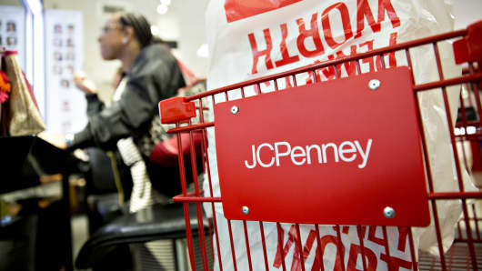 Signage is seen on a shopping cart inside a J.C. Penney Co. store in Peoria, Illinois.