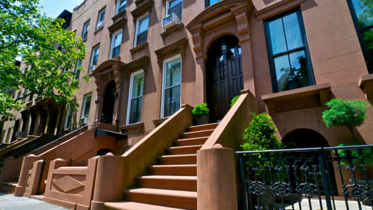 Brownstone row houses in the Cobble Hill neighborhood of Brooklyn, New York.
