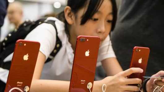 Chinese customers visit an Apple Store in Hong Kong.