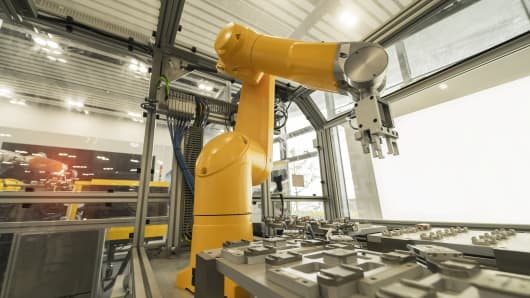 A robotic arm at an industrial manufacturing factory.