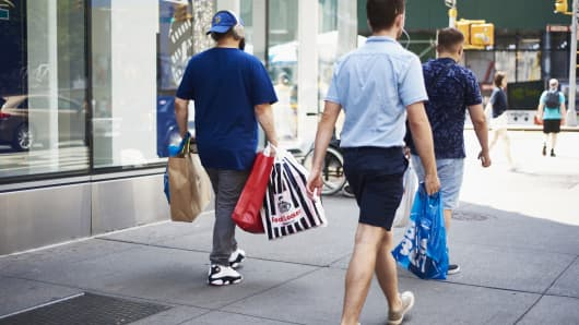 Shoppers carrying retail bags in New York, Aug. 12, 2018.