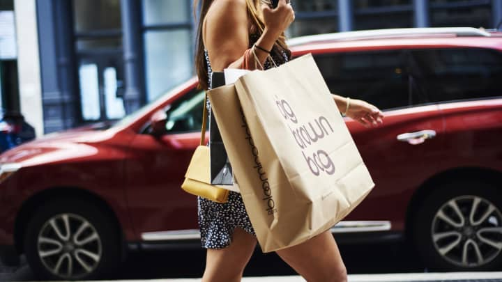 A shopper carries a Bloomingdale's retail bag in the SoHo neighborhood of New York,  Aug. 12, 2018.