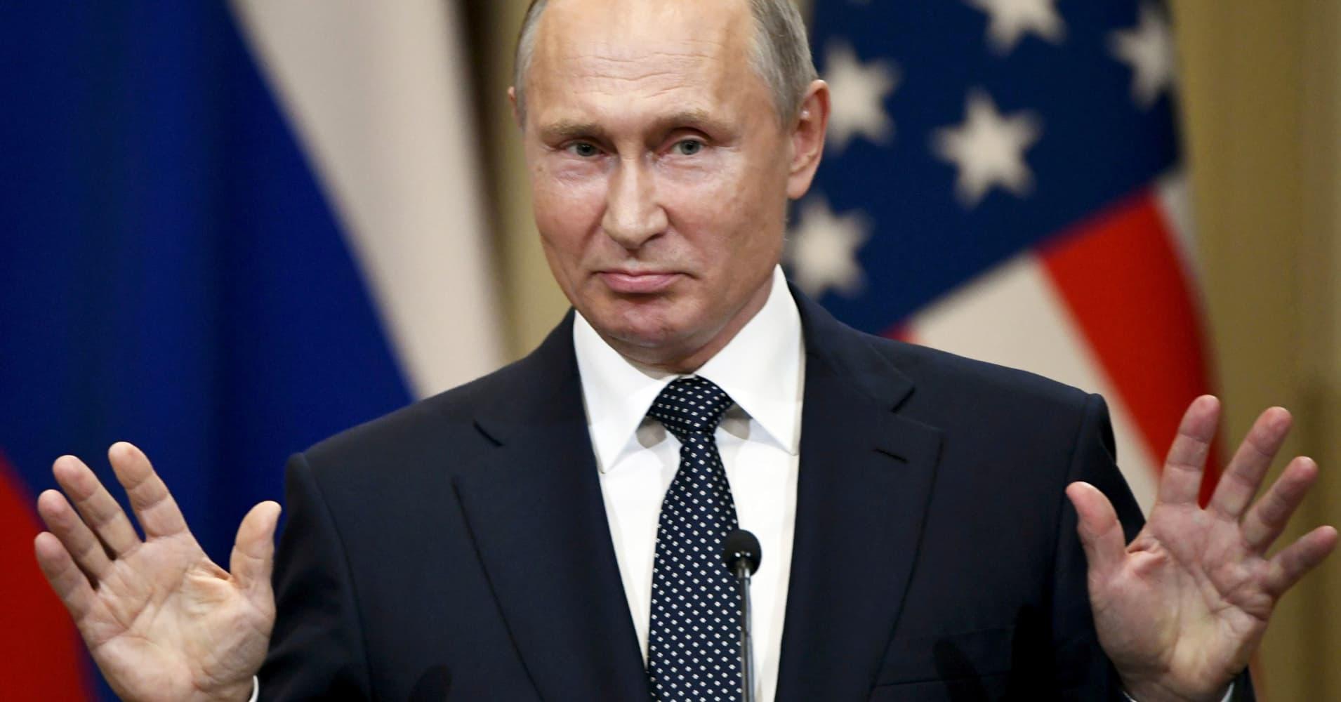 Putin dilutes unpopular pension reform that has hurt his popularity