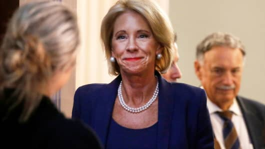 U.S. Education Secretary Betsy DeVos enters the room to take part in a Federal Commission on School Safety meeting at the White House in Washington, D.C., August 16, 2018.