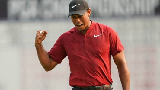 Tiger Woods of the US reacts to making his putt for birdie on the 18th hole during the final round of the 100th PGA Championship held at Bellerive Golf Club on August 12, 2018 in St. Louis, Missouri.