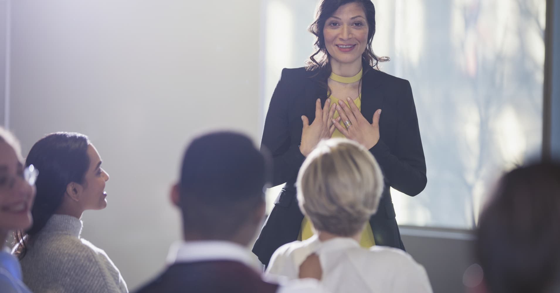 Businesswoman gesturing, leading conference meeting