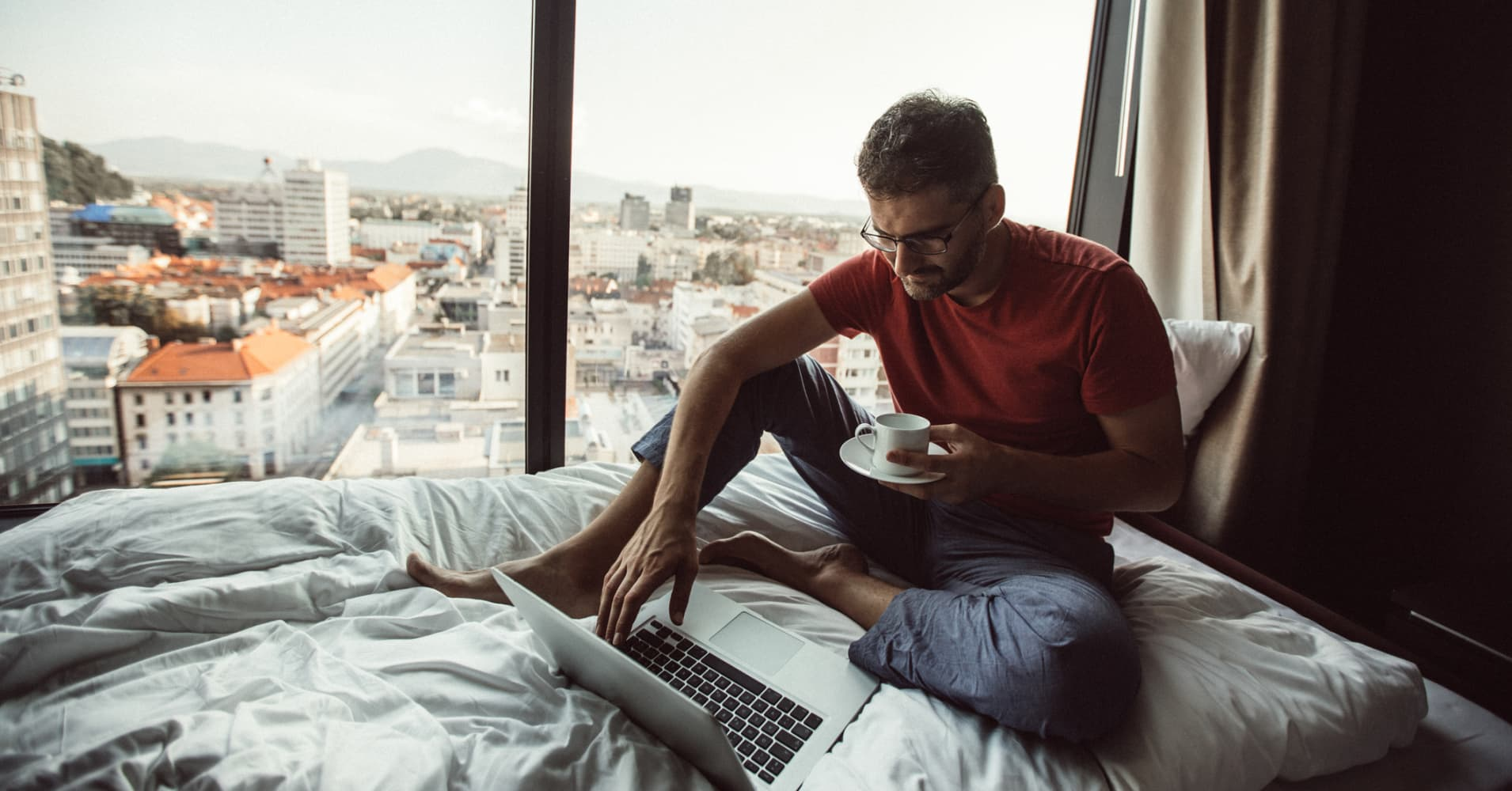 Man in bed using computer