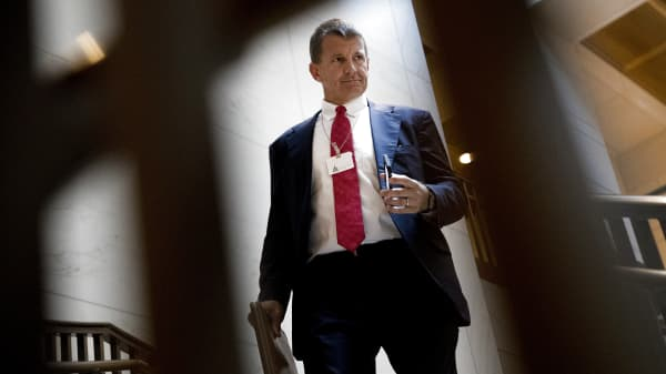 Erik Prince, chairman and executive director of Frontier Services Group Ltd., walks to a closed-door House Intelligence Committee meeting on Capitol Hill in Washington, D.C., Nov. 30, 2017.