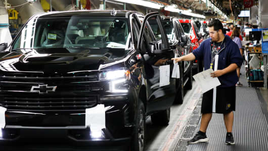 Trucks come off the assembly line at GM's Chevrolet Silverado and GMC Sierra pickup truck plant in Fort Wayne, Indiana, July 25, 2018.