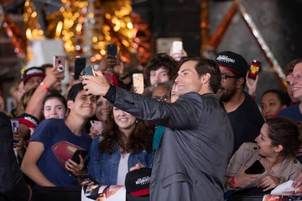 "Actor Henry Cavill who plays ""August Walker"" in Mission: Impossible Fallout, takes selfies with fans, on the red carpet of the U.S. premiere at the Smithsonian National Air and Space Museum in Washington, D.C., on Sunday, July 22, 2018."