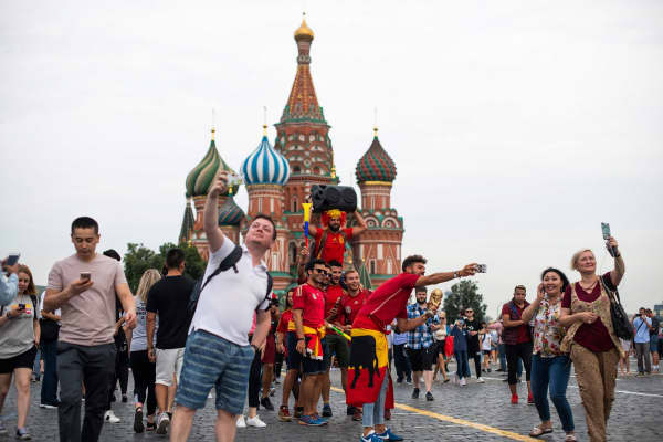 Tourists take photos and selfies at Red Square in Moscow on July 14, 2018.