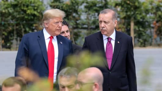 President Donald Trump (L) speaks withh Turkey's President Recep Tayyip Erdogan ahead of the opening ceremony of the NATO (North Atlantic Treaty Organization) summit, at the NATO headquarters in Brussels, on July 11, 2018.