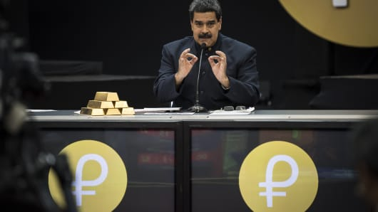 Nicolas Maduro, Venezuela's president, speaks next to a stack of 12 Kilogram gold ingots during a news conference on the country's cryptocurrency, known as the Petro, in Caracas, Venezuela, on Thursday, March 22, 2018.