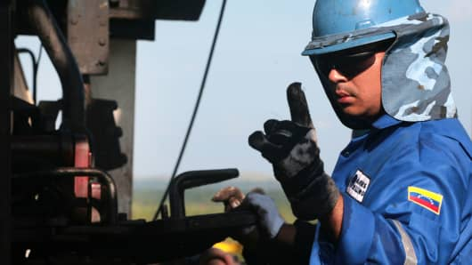 An oil worker on a drilling rig in the Orinoco Belt near San Diego de Cabrutitas, 300 miles from Caracas, Venezuela.