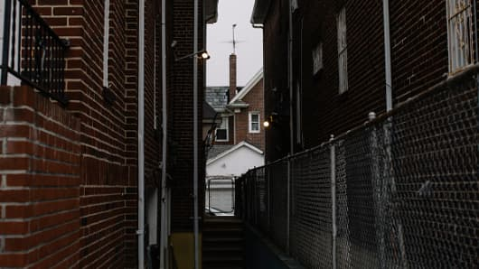View down an alley off of the street where Nazi war criminal Jakiw Palij lives in Queens.
