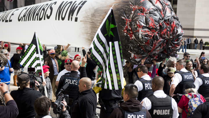 Secret Service block pro-marijuana protesters from carrying their 51-foot inflated marijuana joint down Pennsylvania Avenue in front of the White House on Saturday, April 2, 2016.