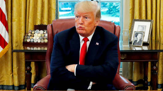 President Donald Trump reacts to a question during an interview in the Oval Office of the White House in Washington, August 20, 2018.