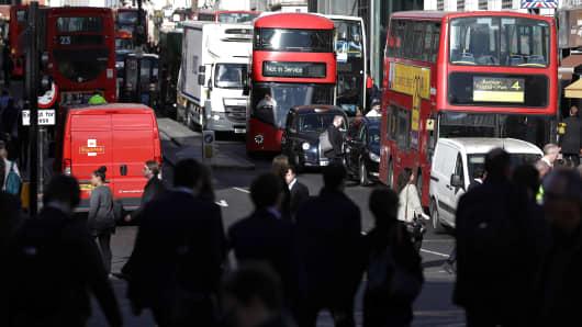 Traffic passes along Fleet Street in London.