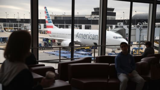 An American Airlines aircraft sits at a gate at O'Hare International Airport on May 11, 2018 in Chicago, Illinois. Today American Airlines held a ceremony to mark the opening of five new gate at the airport.