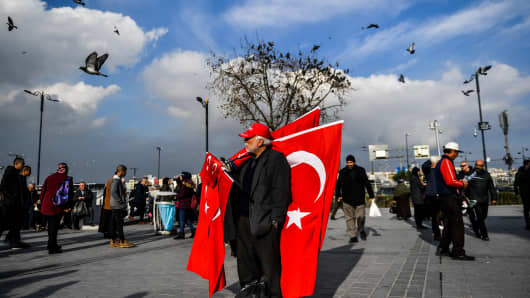 A vendor sells Turkish national flags in Eminonu Square on the European side of Istanbul on January 4, 2018.