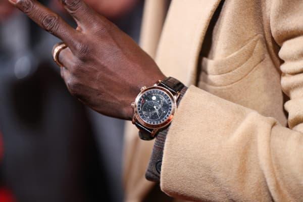 Kevin Hart wearing a six-figure Patek Philippe watch.