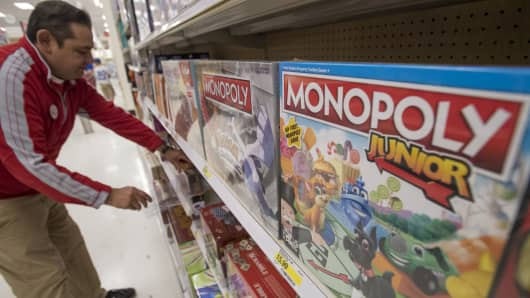 A worker arranges boxes of Hasbro board games on a shelf at a Target Corp. location in Emeryville, California.
