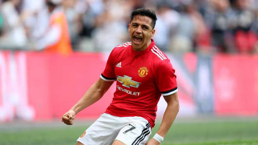Alexis Sanchez of Manchester United celebrates after scoring his sides first goal during The Emirates FA Cup Semi Final match between Manchester United and Tottenham Hotspur at Wembley Stadium on April 21, 2018 in London, England.
