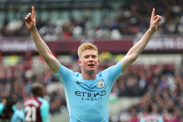 Kevin De Bruyne of Manchester City celebrates after his cross was deflected into the net by Declan Rice of West Ham United (not pictured) for a own goal and Manchester City's second goal of the game during the Premier League match between West Ham United and Manchester City at London Stadium on April 29, 2018 in London, England.