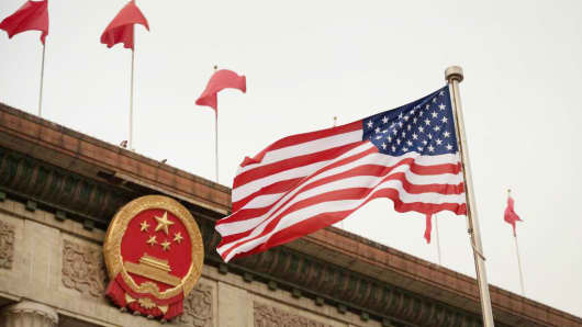 The US flag is seen ahead of a welcome ceremony with U.S. President Donald Trump and Chinese President Xi Jinping outside the Great Hall of the People in Beijing on November 9, 2017.