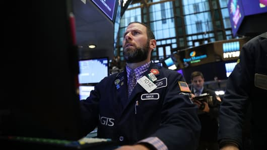 A trader on the floor of the New York Stock Exchange the morning after the Dow Jones Industrial Average dropped over 1,000 points on Feb. 9, 2018.