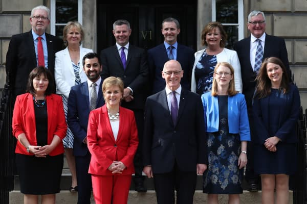 First Minister of Scotland, Nicola Sturgeon and Deputy First Minister John Swinney (centre right), with (left to right, back row) Mike Russell, Roseanna Cunningham, Derek Mackay, Michael Matheson, Fiona Hyslop, Fergus Ewing, (left to right, centre row) Jeane Freeman, Humza Yousaf, Shirley-Anne Somerville and Aileen Campbell during a photocall at Bute House in Edinburgh, following a Scottish cabinet reshuffle.
