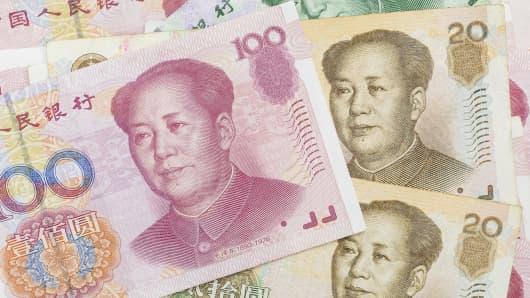 China central bank raises yuan mid-point by the most in nearly 15 months, spurs dollar buying