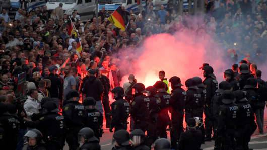 Riot policemen stand guard as the right-wing supporters protest after a German man was stabbed last weekend in Chemnitz, Germany, August 27, 2018.