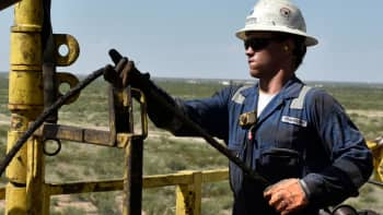 A drilling crew member on an oil rig in the Permian Basin near Wink, Texas.