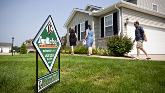 Prospective home buyers arrive with a realtor at a house for sale in Dunlap, Illinois, on Sunday, Aug. 19, 2018.