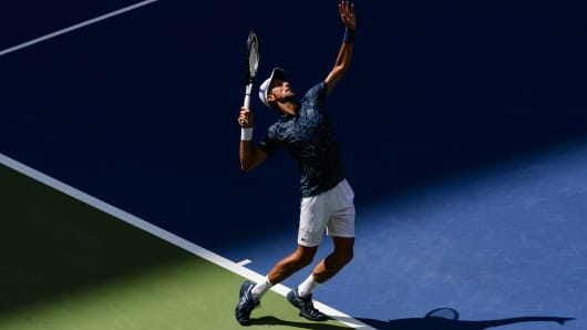 Novak Djokovic of Serbia in action against Marton Fucsovics of Hungary in the first round of the US Open.