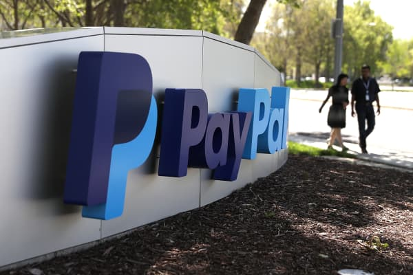 A sign is posted outside of the PayPal headquarters in San Jose, California.