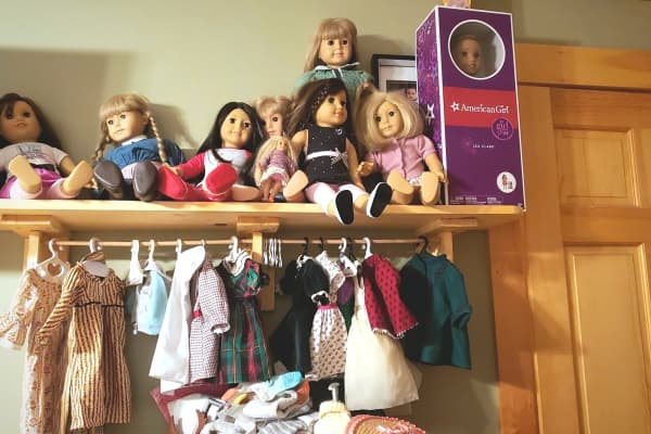 Susan Olsen has collected roughly two dozen American Girl dolls to give away.