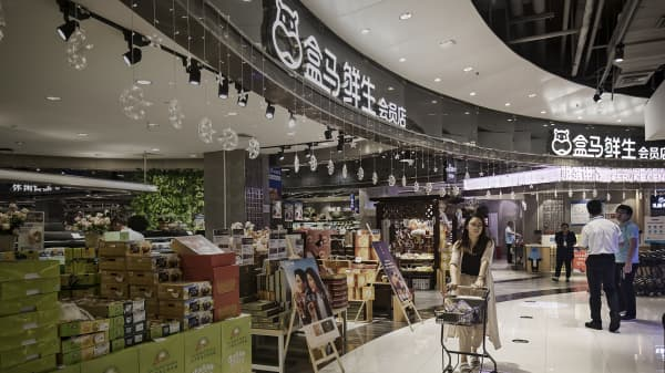 We visited inside Alibaba's new retail store, sweeping through China