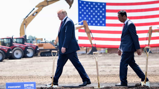 President Donald Trump (L) and Terry Gou, chairman of Apple iPhone manufacturer Foxconn, at a groundbreaking for Foxconn's new LCD screen facility on June 28, 2018 in Mount Pleasant, Wisconsin.