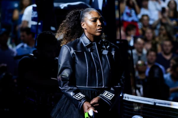 Serena Williams of the United States walks onto Arthur Ashe Arena wearing items from her new Nike off-white collection, designed with Virgil Abloh, for her match against Magda Linette of Poland in the first round of the US Open at the USTA Billie Jean King National Tennis Centre on August 27, 2018 in New York City, United States.