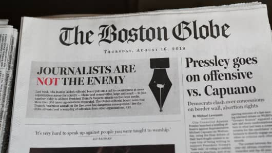 """The front page of the Thursday, August 16, 2018 edition of the Boston Globe newspaper reads """"Journalists are Not the Enemy"""" as it sits for sale on August 16, 2018 in Cambridge, Massachusetts."""