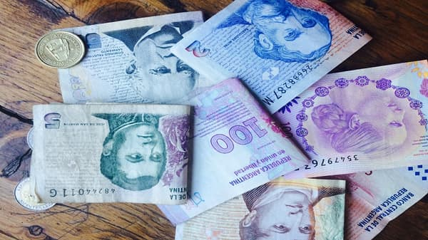 Emerging markets fall as Argentine peso plunges to record low