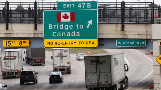 A commercial truck exits the highway for the Bridge to Canada, in Detroit, Michigan, August 30, 2018.