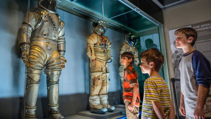 Apollo Astronaut suits on display in the Saturn V Center