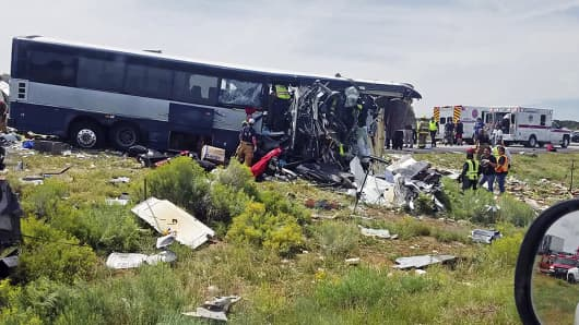 This photo provided by Chris Jones shows first responders working the scene of a collision between a Greyhound passenger bus and a semi-truck on Interstate 40 near the town of Thoreau, N.M., near the Arizona border, Thursday, Aug. 30, 2018.