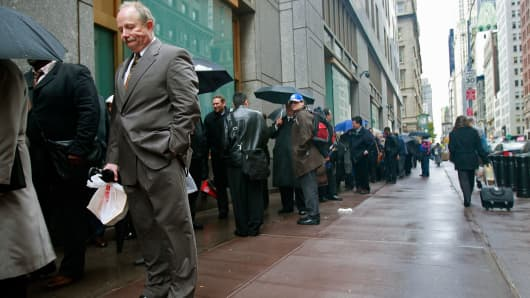 A man waits on line with other job seekers at the Internal Revenue Service (IRS) Career Open House October 28, 2008 in New York City.