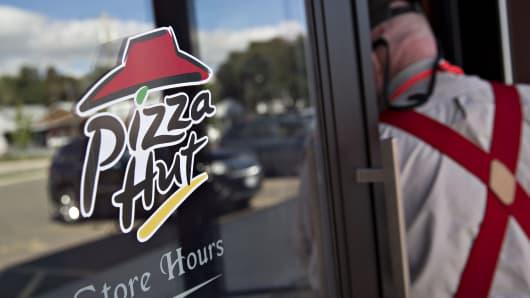 A customer enters a Pizza Hut restaurant in Princeton, Illinois.
