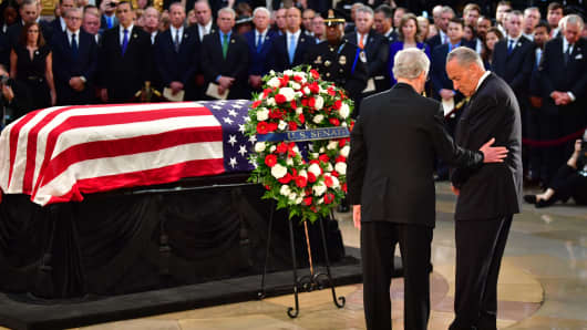 United States Senators Chuck Schumer and Mitch McConnell stand near the casket of late Senator John McCain in the Capitol Rotunda as he lies in state at the U.S. Capitol, in Washington, DC on Friday, August 31, 2018.