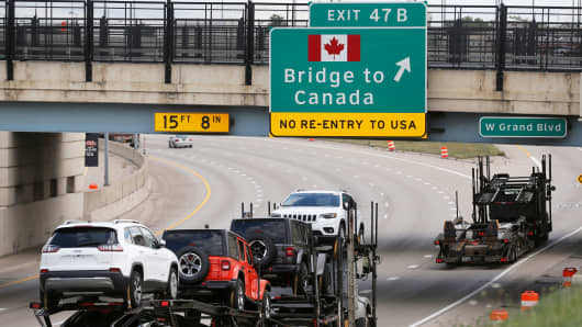 Commercial trucks exit the highway for the Bridge to Canada, in Detroit, Michigan, August 30, 2018